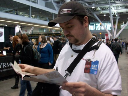 Dave checking the schedule/map
