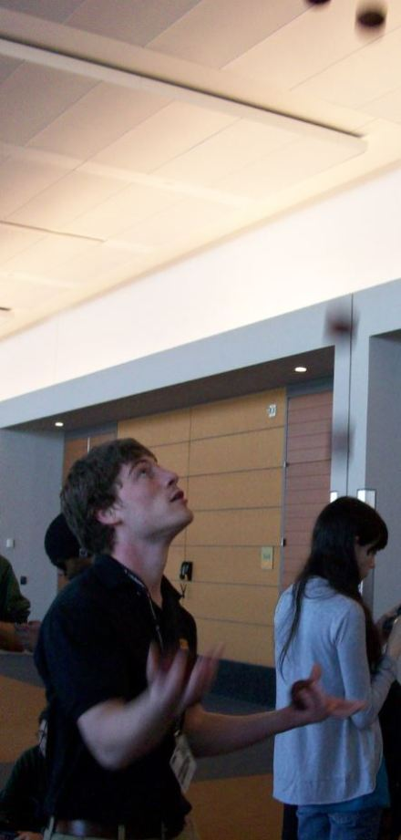 While waiting in line for a panel to start,  this PAX East attendee juggles to pass the time